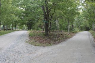 8-Site of the Acorn Schoolhouse in triangle of road intersection